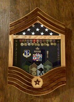 Military Shadow Box. Air Force Chief Master Sergeant Stripe.  $350 solid oak and walnut.  If you are interested in a shadow box, flag case, coin holder or something else, please contact Tom at jenkswood@gmail.com