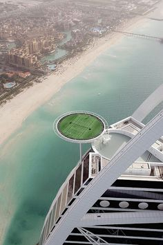 Who's up for playing tennis 1000 feet in the air? You can at the Burj Al Arab hotel in Dubai which is the home of world's highest tennis court. The Burj Al Arab is also the worlds only 7 star hotel - so, when I knock the ball out of the court - will room service go and retrieve it for me?