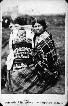 Chippewa woman and child in cradleboard.