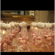 Cake pop place cards.  I made cake pops the night before the party and used them as place cards for each guest at the baptism.