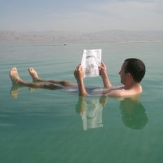 Floating in The Dead Sea. Possibly one of the coolest places I've ever visited.