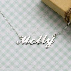Whether you're channeling Carrie Bradshaw's signature style, want a classic necklace you'll cherish for years to come, or want a sentimental gift to give, this personalized name plate necklace checks all the boxes. Handcrafted and hung on a sterling silver cable chain, each piece is custom made to order and comes in a gift box ready to give.