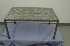 Antique metal table with custom glass and removable center. Stunning antique floral motif, with foundry marks