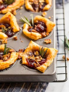 These EASY Baked Brie Bites are the ultimate make-ahead holiday appetizer and will wow your guests! Made with puff pastry, Brie cheese, cranberry, and pecans. Everyone loves this easy recipe! Try them with raspberry jam, apricot, pepper jelly, or a mix! #easyappetizers #puffpastry #holidayappetizers #bakedbrie #wellplated Brie Puff Pastry, Puff Pastry Appetizers, Brie Appetizer, Holiday Appetizers, Appetizer Recipes, Easy Thanksgiving Recipes, Thanksgiving Menu, Christmas Recipes, Holiday Recipes