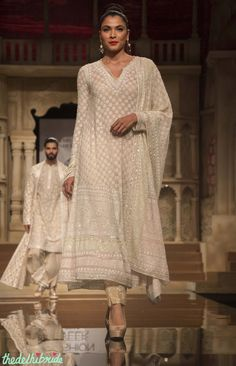 Pretty ivory suit Outfit details: Abu Jani Sandeep Khosla - Off White Embroidered Kurta with Gold Cigarette Pants - BMW India Bridal Fashion Week 2015 Indian Bridal Fashion, Bridal Fashion Week, Indian Attire, Indian Ethnic Wear, Dress Indian Style, Indian Dresses, India Fashion, Asian Fashion, Tokyo Fashion