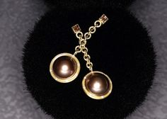 Chocolate Pearl Earrings hanging from Pure Gold Chain