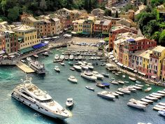Portofino is known as the resort of the rich and famous, but there is much more to see here than just people. Portofino is a picturesque, half-moon shaped seaside village with pastel houses lining the shore of the harbor. Portofino has shops, restaurants, cafes, and luxury hotels. Portofino's crystalline green waters reveal a myriad display of aquatic life. A castle sits atop the hill overlooking the village. There are also opportunities for hiking, diving, and boating.