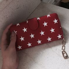 red wallet with stars <3