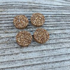 Check out this item in my Etsy shop https://www.etsy.com/listing/549056730/12mm-antique-gold-glitter-druzy-resin