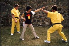 """Bruce Lee and Jim Kelly practicing for an upcoming fight scene on the set of """"Enter the Dragon."""