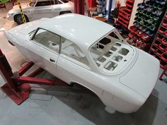 Car painted its original Bianco Spino 013, underside is finished in a high quality protective underseal and then top coat painted for a wipe clean finish.