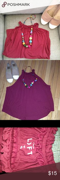 Loft Blouse Pretty and can be dressed up or down, swing shirt with nice neckline.  Size XL. 100% rayon.  Color is a mix burgundy/purple/red. LOFT Tops Blouses