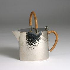 "Peter Behrens; attributed to  Tea Pot  Germany, c. 1915 Nickel- plated metal, wicker handles C. 6 1/8 in. (15.5 cm) high Stamped ""1/2"" on un..."
