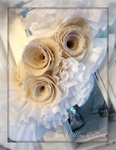 Burlap flowers on a wreath made from coffee filters.