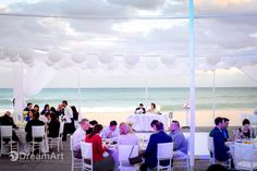 Bride and groom sit at their wedding reception at Playacar Palace Resort. Photo courtesy of #DreamArtPhotography. Special thanks to @prweddings