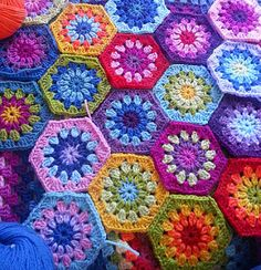 A pattern for a crochet hexagon shape - the pattern is for the motif only, but you could make as many of these as you like to create a throw or blanket.