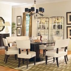My new dining room table set... waited 9 months for my order but it was worth it. Part of Bernhardt's Wilshire Blvd. collection. The two-seaters are alot of fun.