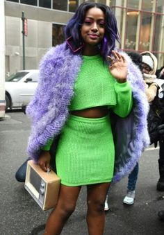 Justine Skye street style, neon cropped top + skirt, pink heels and purple faux fur coat