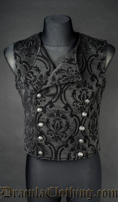 Vest made of thick, especially made for us, brocade black and black material. Fastened with silver buttons up front.