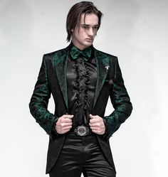 This is kind of fierce.  Love the tailoring and the coat.  Maybe not this colour though. The shirt is headed in right direction, but satin looks cheap. Hate the bowtie as well. Pants looks good though. Headed in right direction.