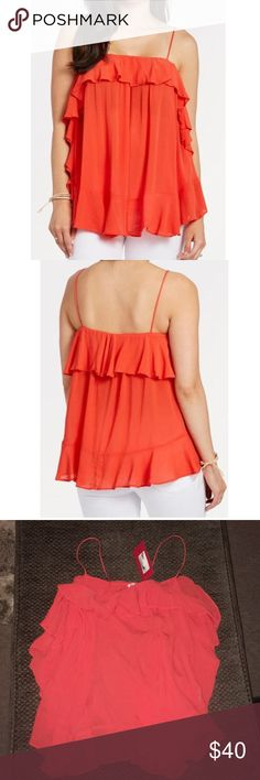 Free People! Orange cascades tank top cami! NWT New with tags! Gorgeous flowy tank! Check out my other listings! Bundle and save:) Free People Tops Tank Tops