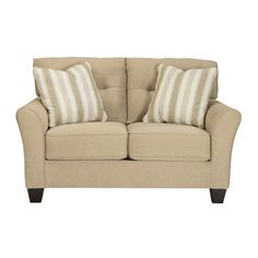 The Laryn Loveseat by Ashley Furniture comes in khaki beige and features tufted back cushions. Durable hardwood frame and clean classic design. Includes 2 striped accent pillows in white and beige. Matching pieces may be available. (Matching Sofa may also be available.) Laryn Loveseat | Weekends Only Furniture and Mattress