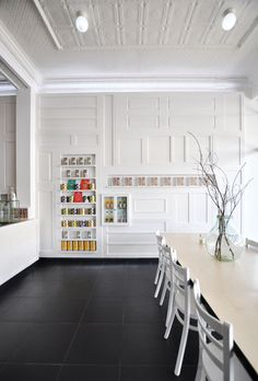 French designer Sasufi used reclaimed wooden doors to recreate the decorative panelling of nineteenth century French interiors on the walls of a patisserie on the outskirts of Melbourne.