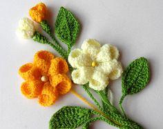Gehaakte stoffen bloemen en bladeren instellen elke kleur