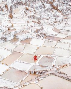 Visit Ancient Salt Mines in Peru | A Peruvian town filled with salt mines, Maras is known to the locals as a sacred valley. Hike the canyon, wander the Moray Inca ruins and explore the salt evaporation ponds and gorgeous surrounds, while crossing epic and free experience in Peru off the bucket list. | Photo Credit: Samuel Taipale