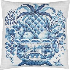 Blue and white cross stitch pillow