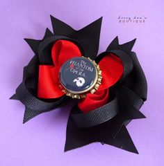 Phantom of the Opera Custom Broadway Bottle Cap Boutique Bow in Black and Red. $7.50, via Etsy.