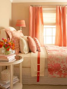 Salmon + Rose        The warm color palette in this enchanting bedroom begins with the walls. Paint in a deep, dusty taupe with whispers of rose creates a feeling of intimacy, while salmon-color silk taffeta draperies define the window and add sheen. A floral duvet on the bed blushes in shades of pink that are echoed in the painted lampshade.