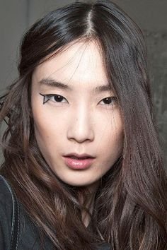 Makeup artist Tom Pecheux created star-inspired lines around the eyes of the models at Anthony Vaccarello.
