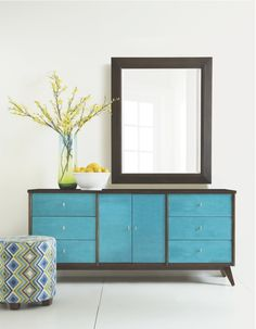 Shown here is an aniline dyed turquoise credenza with a mid century modern design, a colorful new accent being shown this market. This credenza is a great color pop in any room! #HPMKT