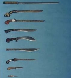 Weapons of Silat. Kriss and machete (Bolo) style knife, traditionally the Kriss is treated with a poison.