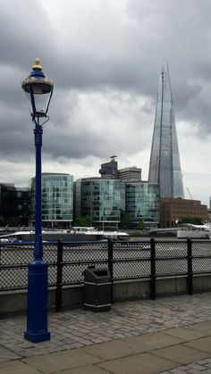 Streetlight along the river Thames in London UK, with the Shard building in the background