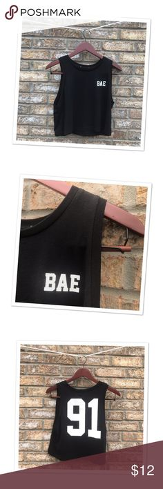"Black ""BAE"" Crop Top This sporty black crop is the next addition to you sports wear collection... or if you are anything like me your collection of athletic wear you wear everywhere but the gym! I love the jersey style number and cute acronym on the front! While this shirt did not come with a brand or sizing tag, it would be best for a medium or small! Pair this with leggings and your go to pair of slides and you have a perfect errand running outfit! The material is incredibly light weight…"