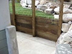 Wood retaining wall butting up to a stone retaining wall Patio Ideas, Backyard Ideas, Wood Retaining Wall, Income Property, Lawn Care, Fencing, Wood Wall, Firewood, Bliss