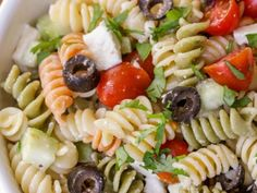 This delicious Greek Pasta Salad is filled with rotini pasta, tomatoes, cucumber, olives, and feta cheese and is covered in a tasty greek dressing! It's our new go-to pasta salad and is perfect especially in spring and summer. Tomato Pasta Salad, Feta Pasta, Easy Pasta Salad Recipe, Greek Salad Pasta, Healthy Salad Recipes, Pasta Recipes, Zoes Kitchen Pasta Salad Recipe, Noodle Salad, Health Recipes