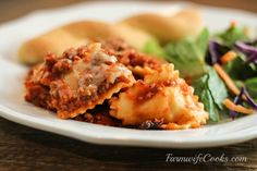 Are you looking for a new crock pot recipe that will be a big hit with the family? This Slow Cooker Cheesy Ravioli Casserole is a family favorite!