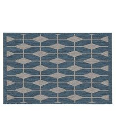 Choose this durable decorative rug as a modern alternative to a doormat. It would be great for the entrance by the back porch.