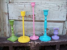 Colorful Candle Sticks - Just search your local antique or second-hand stores, pick your favorite paint colors, and you've got adorable decorations for your apartment - and they're functional for when the lights go out! Diy Candle Holders, Diy Candles, Candlestick Holders, Diy Arts And Crafts, Crafts To Do, Painted Candlesticks, Second Hand Stores, Do It Yourself Home, Cool Diy Projects