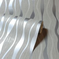 A captivating wave glitter metallic wallpaper in grey and silver from Arthouse. Available at Go Wallpaper UK. Wood Effect Wallpaper, Luxury Wallpaper, Contemporary Wallpaper, Tree Wallpaper, Geometric Wallpaper, Designer Wallpaper Brands, Silver Glitter Wallpaper, Specialist Paint, Little Greene Paint
