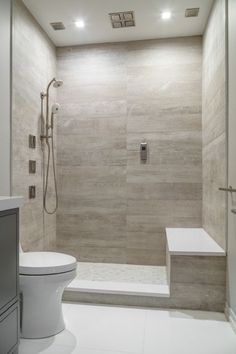 Artistic Tile I Traditional Home's Hamptons Designer Showhouse 2016 I Our Bosco White planks in the last shower offer a zen wood-look that is otherwise hard to achieve in a wet area. I Builder: Frank Bodenchak, assisted by our star design associate Silvana Romano!