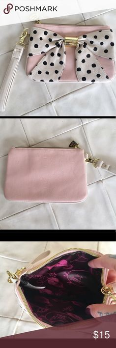 """Betsey Johnson Polk dot bow clutch. Betsey Johnson light pink clutch with Polka dot bow. Newer used, brand new. Very cute clutch comes with a wrist strap. 9"""" length, 5.5"""" height. Betsey Johnson Bags Clutches & Wristlets"""