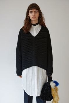 Acne Studios Deborah Lambswool black is a roomy fitting sweater with a very  deep v-neck in a full cardigan stitch.