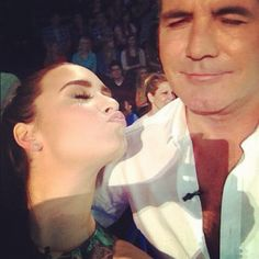 Simon Cowell Practicing for Fatherhood With a Doll