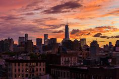 Lower Manhattan and One World Trade Center Under a Colorful September Sunset by urbanzin