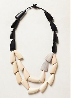 The geometric beads and black and white colors are a good combo.
