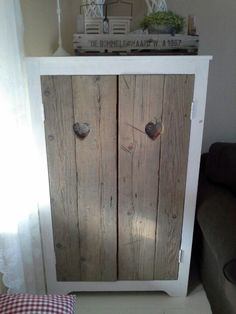 Cupboard with heart hole handles